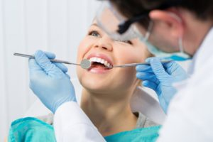 woman with no cavities at dental checkup