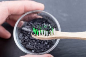 toothbrush dipped in black charcoal