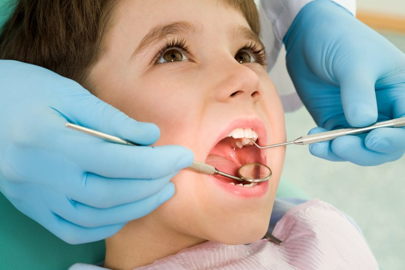 a child in the dentist chair having their teeth checked